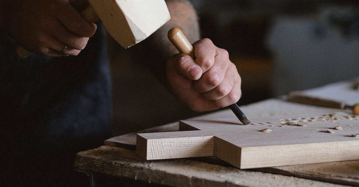 A close up of a person cutting a piece of paper